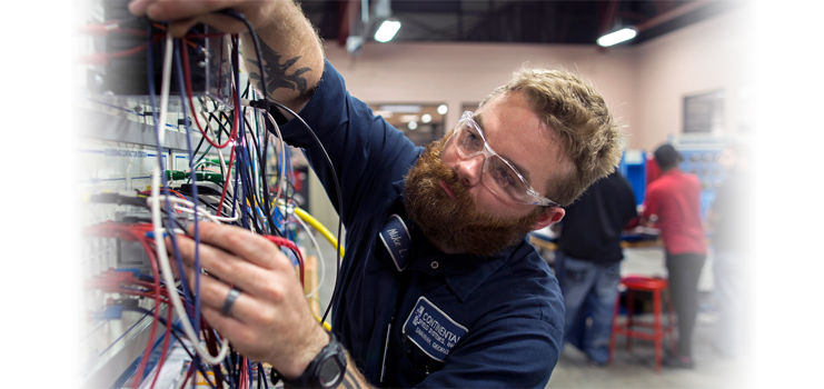 Industrial Maintenance Systems student working on wiring