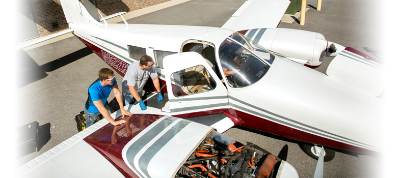 Aviation Maintenance students working on airplane