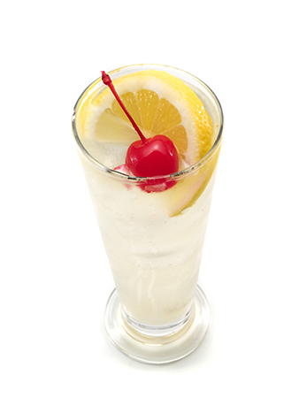 French 75 champagne cocktail with lemon slice and cherry
