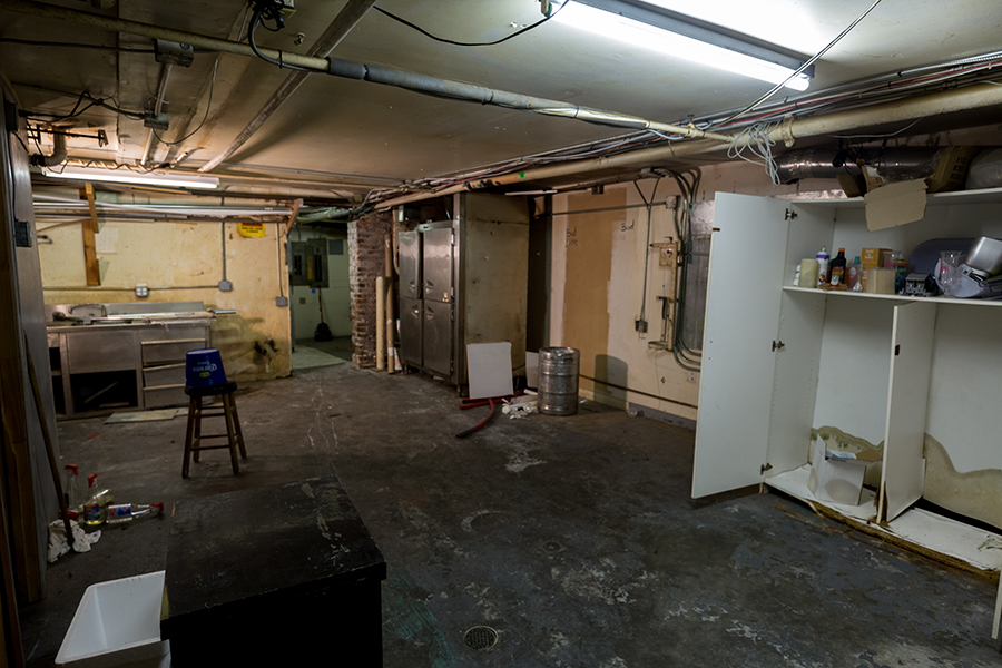 Basement of 7 West Bay showing old kitchen