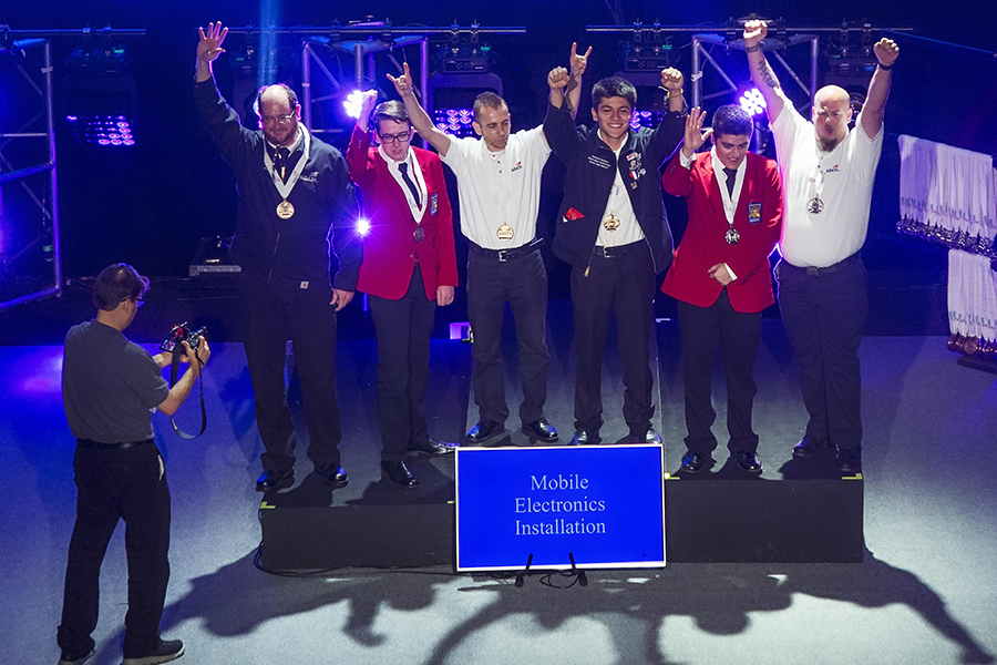 SkillsUSA national winners on podium - Mobile Electronics Installation