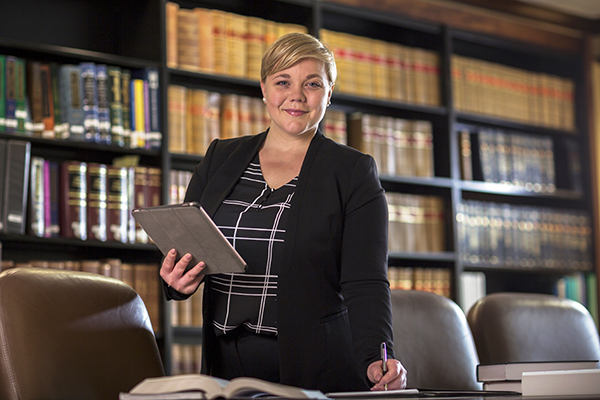 Renea Hanna standing at a conference table in a law library.