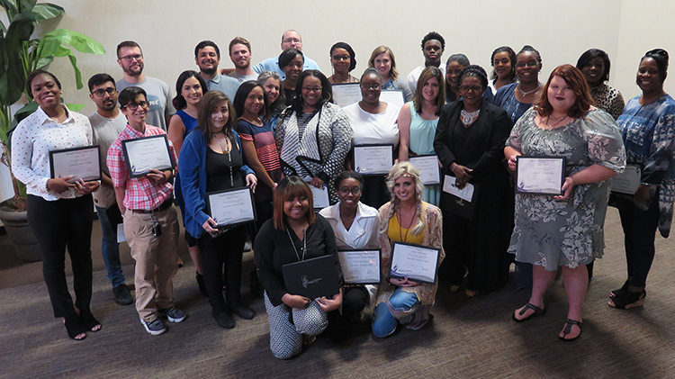 Twenty-eight Savannah Technical College students (group photo) were inducted into the National Technical Honor Society (NTHS) at a ceremony recently at STC's Eckburg Auditorium.