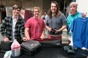 Group of four film dual enrollment students with gear